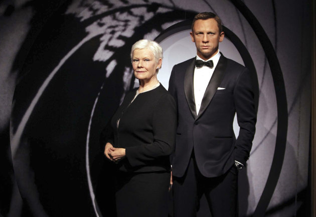 Wax models of James Bond movie characters Daniel Craig, right, and Judi Dench appear in a new James Bond 007 type setting at Madame Tussauds wax works in London, Monday Oct. 29, 2012. (AP Photo / Sean Dempsey, PA) UNITED KINGDOM OUT - NO SALES - NO ARCHIVES