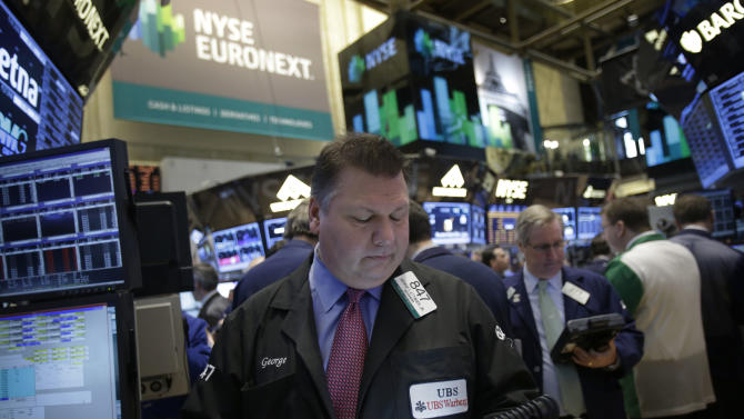 Traders work on the floor at the New York Stock Exchange in New York, Tuesday, Feb. 19, 2013. Talk of more mergers and acquisitions is sending stock prices slightly higher in early trading, setting the market up to continue a seven-week rally.  (AP Photo/Seth Wenig)