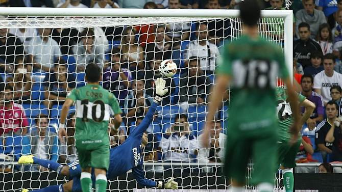 Elche's Edu Albscar , right, scores, as Real's Keylor Navas, centre, tries to save, during a Spanish La Liga soccer match between Real Madrid and Elche at the Santiago Bernabeu stadium in Madrid, Spain, Tuesday, Sept. 23, 2014.