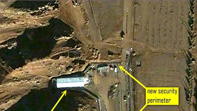 """In this  image released by ISIS,  commercial satellite imagery from December 9, 2012 showing ongoing construction, a new security perimeter, and new roofing on the two major buildings at the site. International officials engaged in a two-pronged effort Wednesday Dec. 12 2012 to engage Iran over concerns the country may have worked on nuclear weapons, with a U.N. team seeking access to a site  linked to such suspected activity and European Union negotiators looking to restart talks with Tehran meant to ease such fears.  Emailing a series of commercial satellite photographs to The Associated Press Wednesday, the Institute for Science and International Security said the images showed """"a steady pace of what appears to be the """"reconstruction"""" phase of the site which between April and July 2012 had undergone considerable alterations. (AP Photo / ISIS)"""