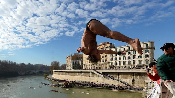 File picture shows Marco Fois making his dive into the Tiber river as part of traditional New Year celebrations on January 1, 2014 in Rome