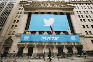 A sign displays the Twitter logo on the front of the New York Stock Exchange ahead of the company's IPO in New York