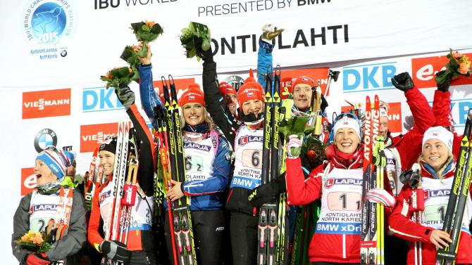 The Czech Republic team celebrates on the podium with second placed France and third placed Norway after winning the Mixed Relay competition at the IBU Biathlon World Championships in Kontiolahti