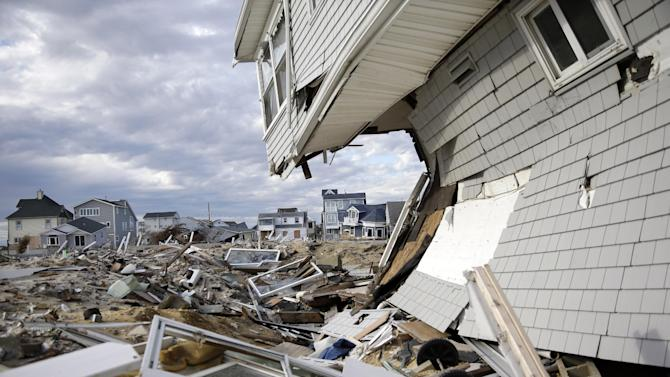 Homes destroyed last October by Superstorm Sandy are seen Thursday, April 25, 2013, at Ortley Beach, in Toms River, N.J. Six months after Sandy devastated the Jersey shore and New York City and pounded coastal areas of New England, the region is dealing with a slow and frustrating, yet often hopeful, recovery. (AP Photo/Mel Evans)