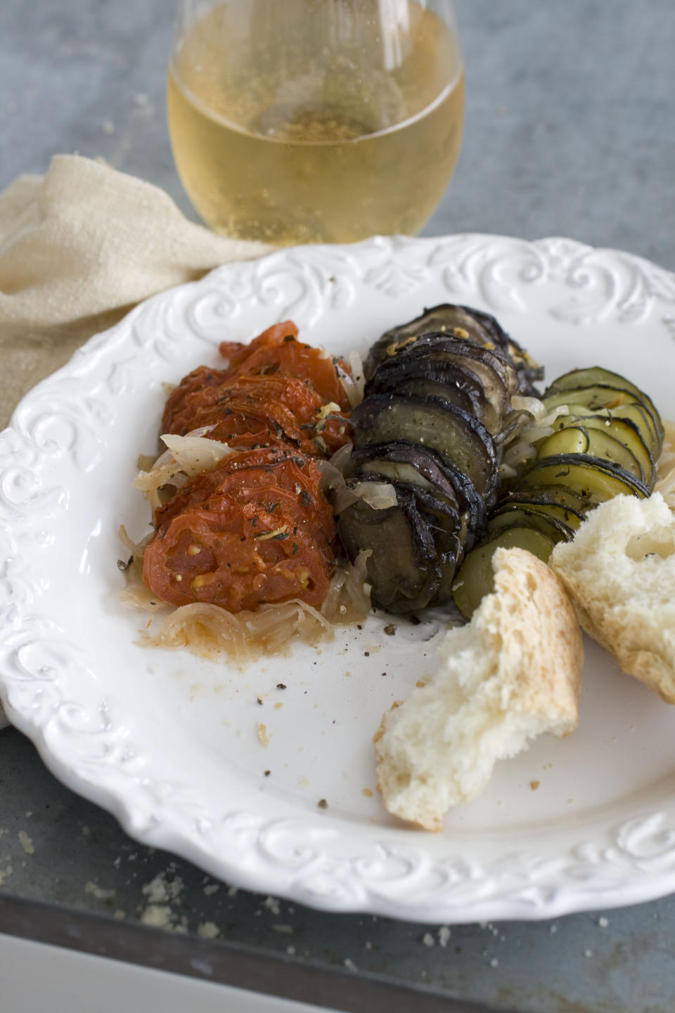 In this image taken on April 15, 2013, ratatouille tian is shown served on a plate in Concord, N.H. (AP Photo/Matthew Mead)