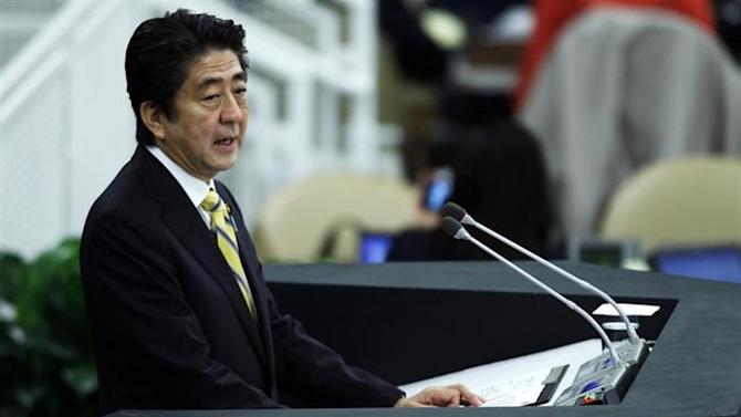 Japan's Prime Minister Shinzo Abe addresses a High-Level Meeting on Nuclear Disarmament during the 68th United Nations General Assembly at U.N. headquarters in New York, September 26, 2013. REUTERS/Eduardo Munoz