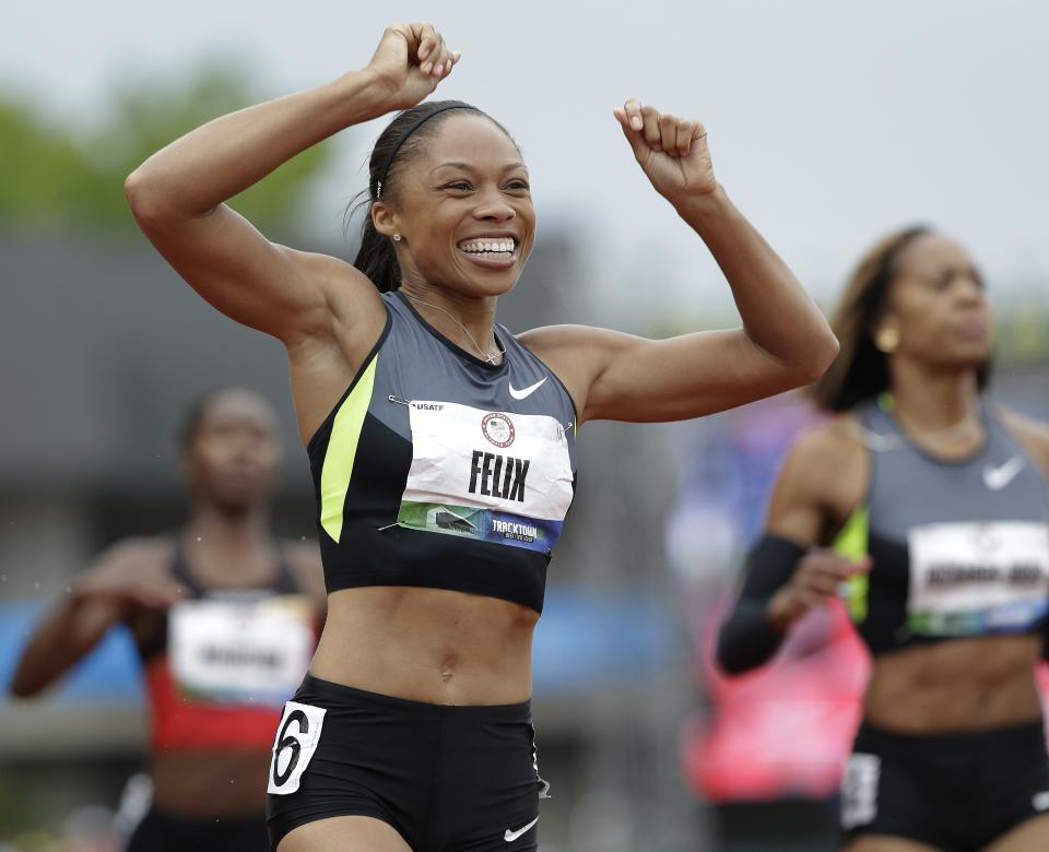Allyson Felix celebrates her first place finish in the women's 200 meters at the U.S. Olympic Track and Field Trials Saturday, June 30, 2012, in Eugene, Ore. (AP Photo/Eric Gay)
