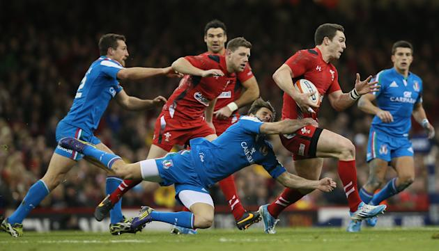 Wales's George North, second right is tackled by Italy's Angelo Esposito, center, during their Six Nations international rugby union match between Wales and Italy at the Millennium stadium in