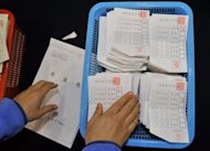 A South Korean election official counts ballots for the presidential election at a high school gymnasium in Seoul on December 19, 2012. South Korea has elected its first female president, handing a slim but historic victory to conservative ruling party candidate Park Geun-Hye, daughter of the country's former military ruler