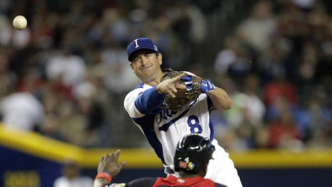 Italy second baseman Nick Punto (8) throws to first for the double play hit into by United States's Ryan Braun after forcing Brandon Phillips out at second during the first inning of a World Baseball Classic game Saturday, March 9, 2013, in Phoenix. (AP Photo/Charlie Riedel)