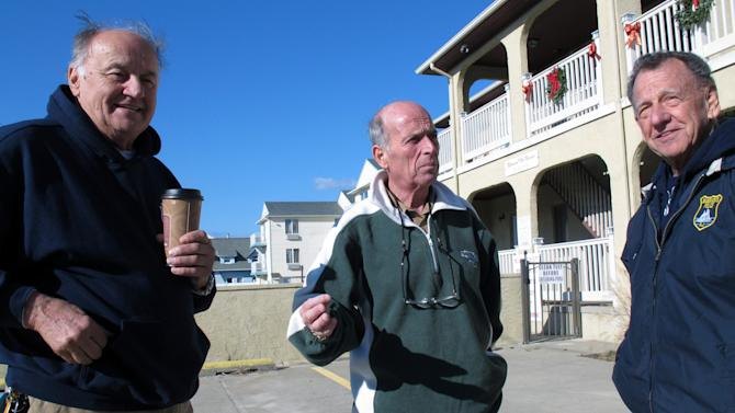 Guy Mazzanti, left, Tony Vaz, center, and Al Poane, right, talk about moving back into Seaside Heights, N.J. on Monday, Jan. 7, 2013, nine weeks after Superstorm Sandy flooded their homes and forced them into temporary housing. The men each rented condominium units Monday until repairs on their homes can be completed. Monday was the first day authorities let residents move back home permanently in Seaside Heights, as well as parts of Toms River and Brick. (AP Photo/Wayne Parry)