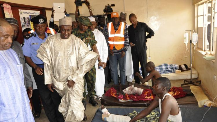 Kaduna State Police Commissioner Alhaji Umar Shehu and Kaduna State Governor Mukhtar Yero visit the victims of a suicide bomb blast at 44 Military Hospital in Kaduna