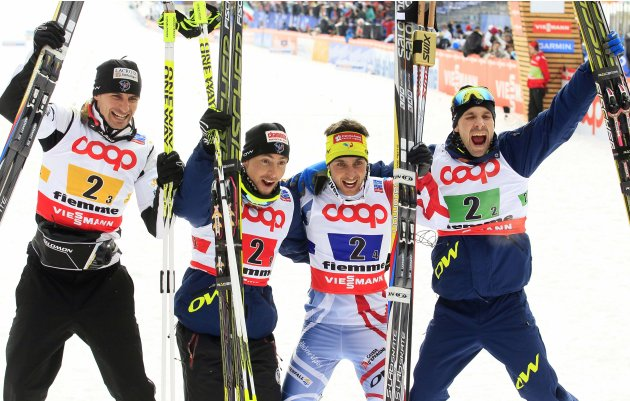 France's Sebastien Lacroix, Francois Braud, Jason Lamy Chappuis and Maxime Laheurte celebrate their victory in the Nordic Combined Team Gundersen competition at the Nordic Ski World Championships in V