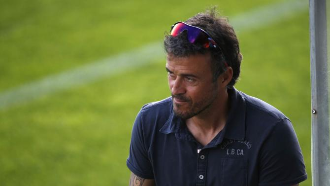 Barcelona's coach Luis Enrique looks at the players before their training session at Ciutat Esportiva Joan Gamper training grounds