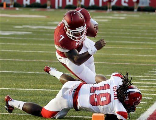 Wilson leads Arkansas by Jacksonville State 49-24