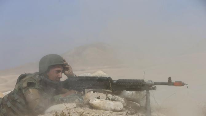 Afghan National Army (ANA) soldier takes part in training exercise at Kabul Military Training Centre (KMTC) in Kabul