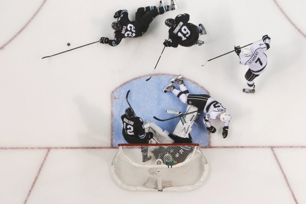 Sharks' Dan Boyle slides to block the puck in the third period during Game 3 of their NHL Western Conference semifinal playoff hockey game against the Kings in San Jose