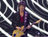 Ronnie Wood of The Rolling Stones performs at the O2 arena in east London, Sunday, Nov. 25, 2012. The band are playing four gigs to celebrate their 50th anniversary, including two shows at London's O2 and two more in New York. (Photo by Joel Ryan/Invision/AP)