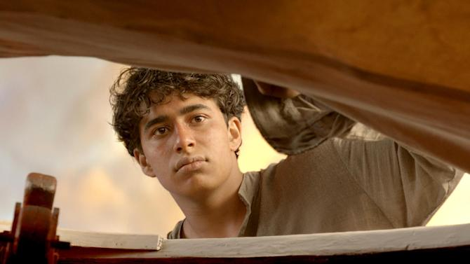 "FILE - This publicity film image released by 20th Century Fox shows Suraj Sharma as Pi Patel in a scene from ""Life of Pi.""  The film is based on the best-selling novel by Canadian author Yann Martel, a globe-trotting writer born in Spain. (AP Photo/20th Century Fox, File)"