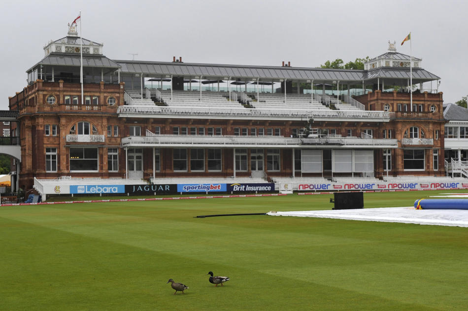 Two ducks walk in front of the pavilion before the start of the 4th day of the second Test match between England and Sri Lanka at Lord's cricket ground, London, Monday June 6, 2011.  Heavy rain soaked