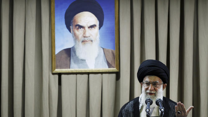 In this photo released by an official website of the Iranian supreme leader's office and taken on Tuesday, July 24, 2012, Iranian supreme leader Ayatollah Ali Khamenei delivers a speech under a portrait of late revolutionary founder Ayatollah Khomeini, in Tehran, Iran. Iran's Supreme Leader says Western-led sanctions and pressure will not force Iran to change its policies, voicing confidence that the country can beat the latest moves to block its vital oil and banking industries. (AP Photo/Office of the Supreme Leader)