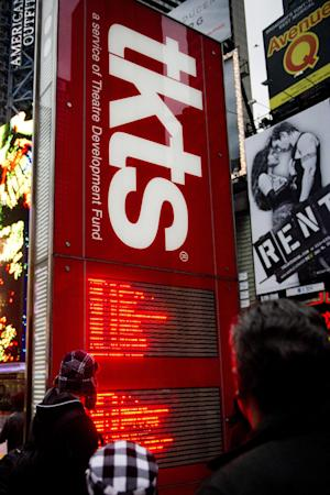 FILE - This Jan. 19, 2012 file photo shows the Times Square TKTS discount ticket booth in New York. The Theatre Development Fund, the nonprofit which runs the red TKTS booth, said tickets for matinee and evening shows will be sold simultaneously starting Monday. Previously, matinee tickets were sold only from 10 a.m. to 2 p.m. and evening tickets were only available after 3 p.m.  The fund also will allow ticket buyers to buy full-price tickets to all shows _ either in the future or for that same day. Until now, the booth has never sold full-price tickets. (AP Photo/Charles Sykes, file)