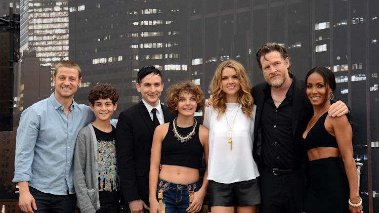 "Benjamin McKenzie, from left, David Mazouz, Robin Taylor, Camren Bicondova, Erin Richards, Donal Logue, and Jada Pinkett Smith pose at the ""Gotham"" press line on Day 3 of Comic-Con International on Saturday, July 26, 2014, in San Diego. (Photo by Tonya Wise/Invision/AP)"