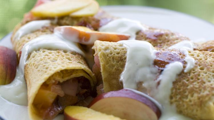 This July 8, 2013 photo shows corn crepes stuffed with summer fruits in Concord, N.H. One of the earliest French culinary imports to make a dent in America was the crepe. (AP Photo/Matthew Mead)