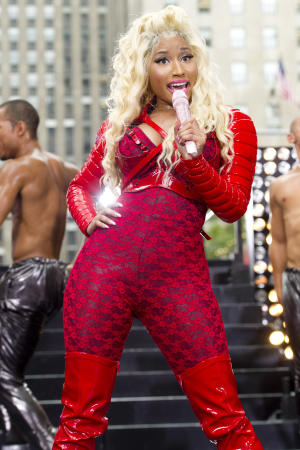 """FILE - This Aug. 14, 2012 file photo shows Nicki Minaj performing on NBC's """"Today"""" show in New York. A source close to Minaj said the singer-rapper has been in talks to judge """"American Idol"""" and that a deal is in works. The person was not authorized to publicly discuss details and spoke on condition of anonymity. (Photo by Charles Sykes/Invision/AP, file)"""