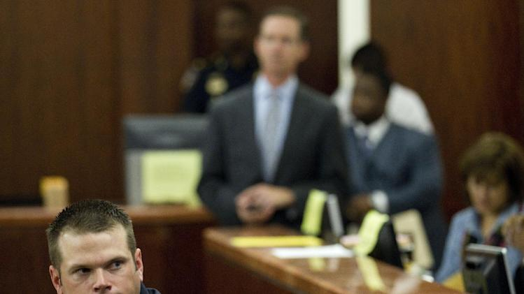 Former Houston police officer Andrew Blomberg sits in the courtroom during his trial Tuesday, May 15, 2012, in Houston. Blomberg is accused of participating in the videotaped beating of a 15-year-old burglary suspect. (AP Photo/Houston Chronicle, Brett Coomer)