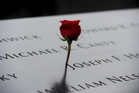 A single rose is seen on inscribed names during memorial observances held at the site of the World Trade Center in New York