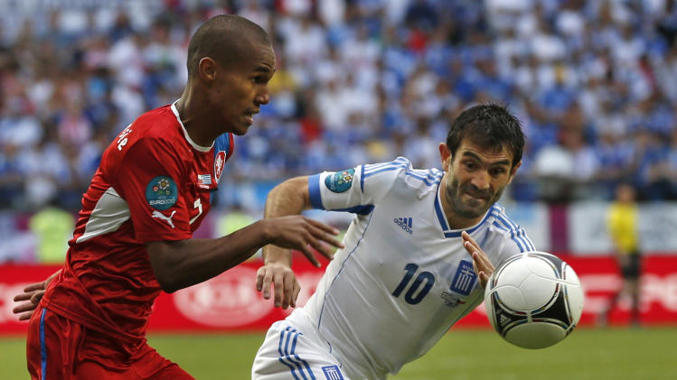 Greece's Giorgos Karagounis, right, and Czech Republic's Theodor Gebre Selassie challenge for the ball  during the Euro 2012 soccer championship Group A match between Greece and Czech Republic in Wroclaw, Poland, Tuesday, June 12, 2012. (AP Photo/Petr David Josek)