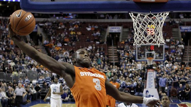FILE - This Jan. 11, 2012 file photo shows Syracuse's Dion Waiters (3) going up for a dunk in the second half of an NCAA college basketball game against the Villanova, in Philadelphia. Waiters is a possible pick in the NBA Draft on June 28. (AP Photo/Matt Slocum, File)