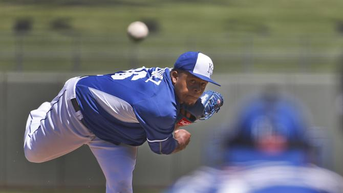 Seattle Mariners starter Edinson Volquez throws a pitch during the first inning of a  spring training baseball game against the Chicago Cubs Sunday, March 29, 2015, in Surprise, Ariz.  (AP Photo/Lenny Ignelzi)