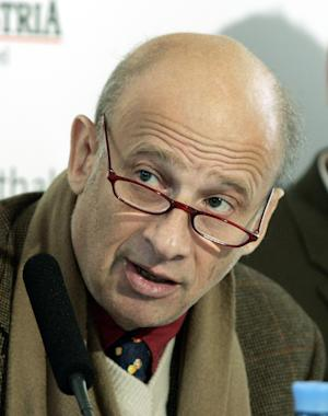 "FILE - In this Dec. 14, 2006 file photo, Luc Bondy, director of the Vienna Festival speaks during a news conference in Vienna. The Metropolitan Opera has abandoned a new production of Verdi's ""Rigoletto"" by director Luc Bondy, whose grim version of Puccini's ""Tosca"" provoked intense booing when it opened the 2009-10 season. In its place, the company will present a far more radical reinterpretation that relocates the action to Ratpack-era Las Vegas of 1960. (AP Photo/Hans Punz, file)"