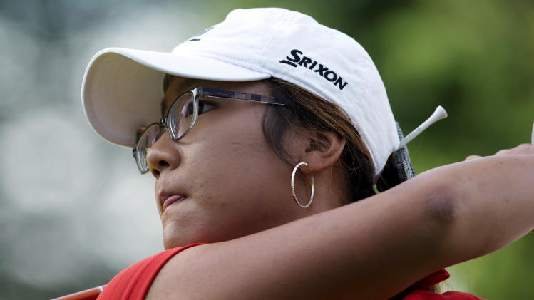 Lydia Ko, of New Zealand, watches her tee shot on the ninth hole during the final round of the LPGA Tour's Canadian Women's Open golf tournament, Sunday, Aug. 26, 2012, at the Vancouver Golf Club in Coquitlam, British Columbia. (AP Photo/The Canadian Press, Darryl Dyck)