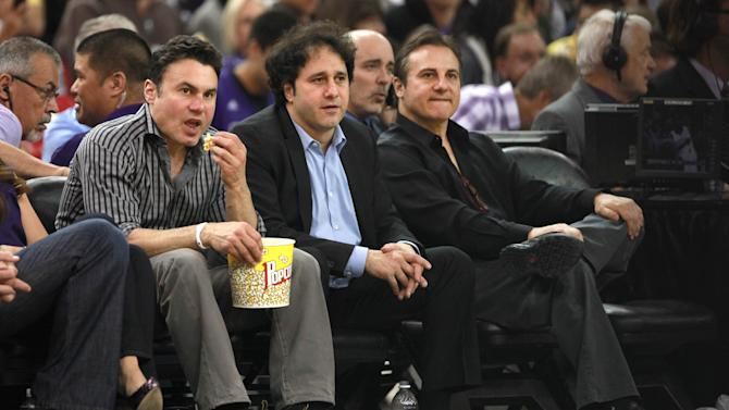 FILE - In this April 26, 2012 file photo, the Maloof brothers, Phil, left, George, center and Gavin, co-owners of the Sacramento Kings, watch their team against the Los Angeles Lakers during an NBA basketball game in Sacramento, Calif.  The only thing stopping the Kings from a sale and move to Seattle is approval by NBA owners.The Maloof family has agreed to sell the Kings to a Seattle group led by investor Chris Hansen, the league confirmed in a statement Monday morning, Jan. 21, 2013.. The deal is still pending a vote by the NBA Board of Governors. (AP Photo/Rich Pedroncelli, FILe)