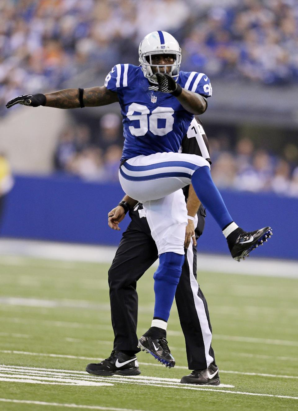 Indianapolis Colts outside linebacker Robert Mathis celebrates a defensive stop against the Miami Dolphins during the first half of an NFL football game in Indianapolis, Sunday, Nov. 4, 2012. (AP Photo/Darron Cummings)