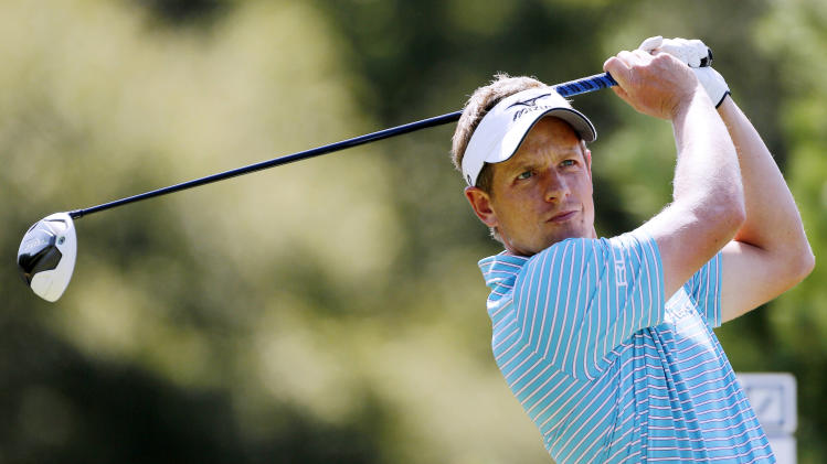 Luke Donald tees off on the seventh hole during the Pro Am round of the Deutsche Bank Championship golf tournament at TPC Boston in Norton, Mass., Thursday, Aug. 30, 2012. (AP Photo/Michael Dwyer)