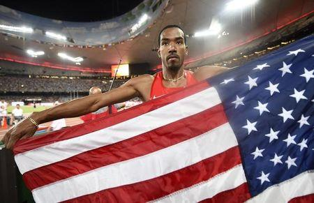 Taylor takes triple-jump gold with second-longest ever leap