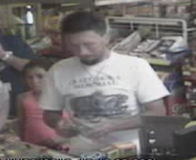 In this photo made from surveillance video and released by the Tennessee Bureau of Investigation, Adam Mayes, 35, stands in front of the counter at a convenience store on April 30, 2012 in Union Count