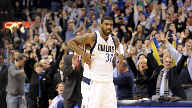 Dallas Mavericks guard O.J. Mayo celebrates after his three-pointer sent an NBA basketball game against the Oklahoma City Thunder into overtime, Friday, Jan. 18, 2013, in Dallas. (AP Photo/Matt Strasen)