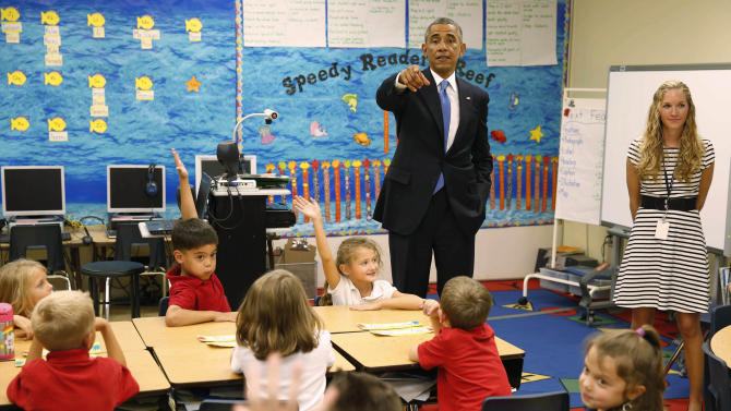 U.S. President Obama visits the classroom of teacher Slagal, during a visit to the Clarence Tinker elementary schoolchildren while at MacDill Air Force Base in Tampa