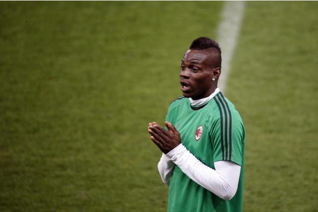 AC Milan's Mario Balotelli gestures during a training session at the Vicente Calderon stadium in Madrid