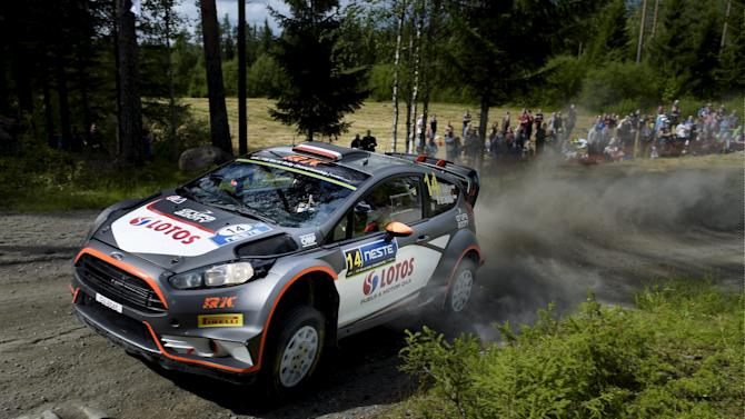 Polish Ford Fiesta RS WRC driver Robert Kubica and co-pilot Maciek Szczepaniak compete in the Mokkipera special stage of 2015 World Rally Championship's Rally Finland