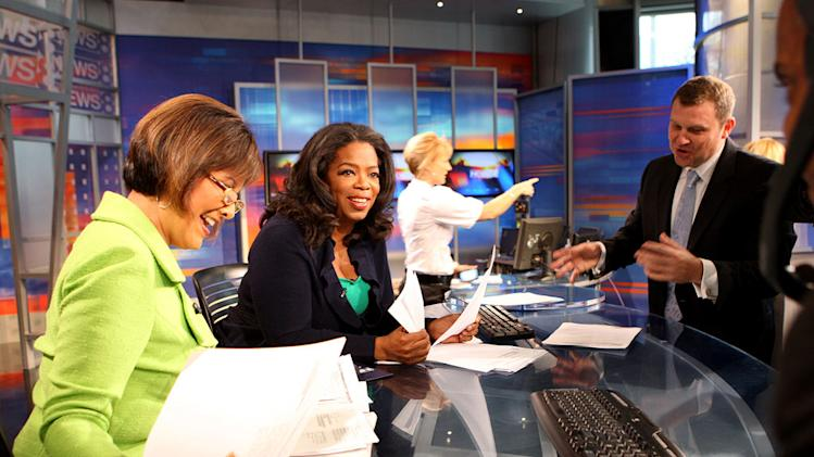 "Oprah returns to her first job at a news desk as seen on ""The Oprah Winfrey Show."""