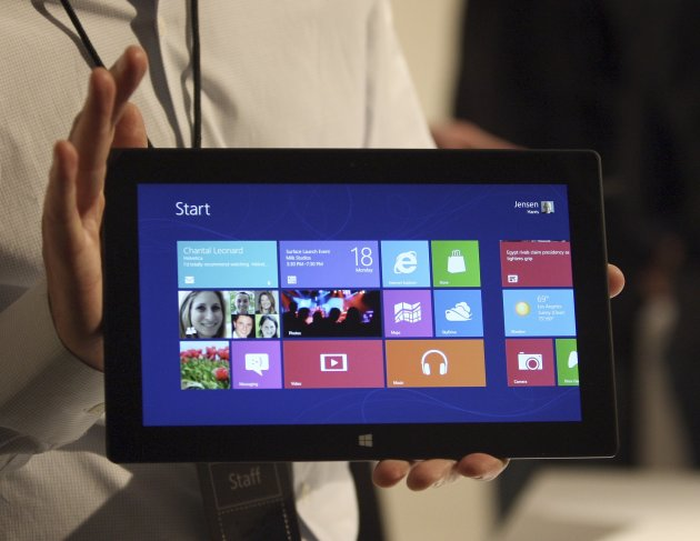 A Microsoft representative holds a new Surface tablet computer as it is unveiled by Microsoft in Los Angeles
