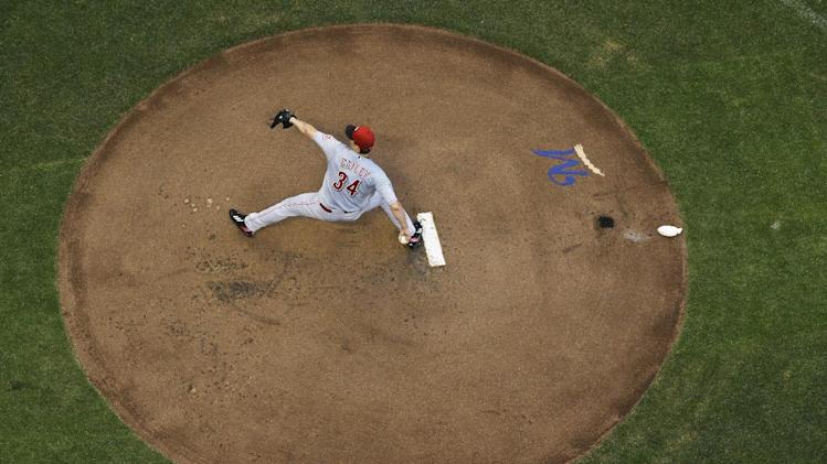 Cincinnati Reds starting pitcher Homer Bailey throws during the first inning of a baseball game against the Milwaukee Brewers Tuesday, July 22, 2014, in Milwaukee. (AP Photo/Morry Gash)
