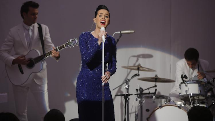 "Singer Katy Perry performs her song ""Roar"" at an event for the Special Olympics hosted by President Barack Obama in the State Dining Room at the White House in Washington, Thursday, July 31, 2014. (AP Photo/Charles Dharapak)"