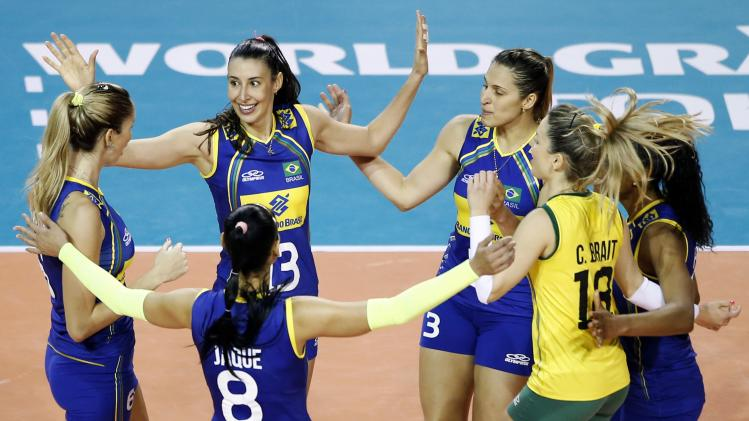Sheilla Castro De Paula Blassioli of Brazil and teammates celebrate after winning a point against China during their FIVB Women's Volleyball World Grand Prix 2014 final round match in Tokyo